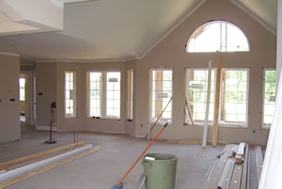 Painting the living room of the Nolan residence by David Barr Construction